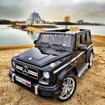 Электромобиль Mercedes-Benz G63 AMG черный глянец (колеса резина, сиденье кожа, пульт, музыка)